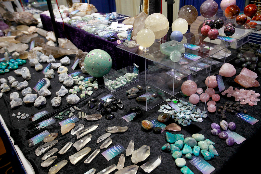 . Evan Anderson from Hunington Beach displays some of his stones, rocks and crystals at the Gem Faire at the Monterey Fairgrounds on Sunday, Nov. 27, 2016.  (Vern Fisher - Monterey Herald)