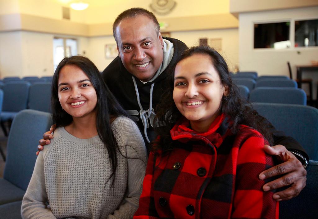 . Yogesh Prasad with his daughters Yojna Prasad and Sheenal Prasad in Seaside on Monday, Nov. 28, 2016.  (Vern Fisher - Monterey Herald)