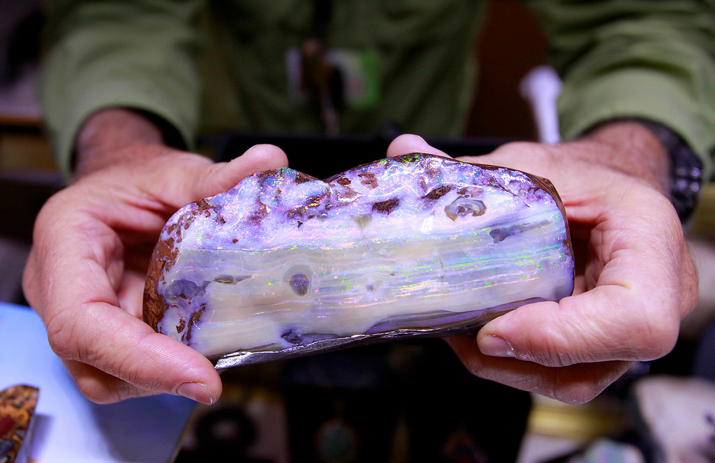 . Robert Sanger from San Diego holds a boulder opal stone at the Gem Faire at the Monterey Fairgrounds on Sunday, Nov. 27, 2016.  (Vern Fisher - Monterey Herald)