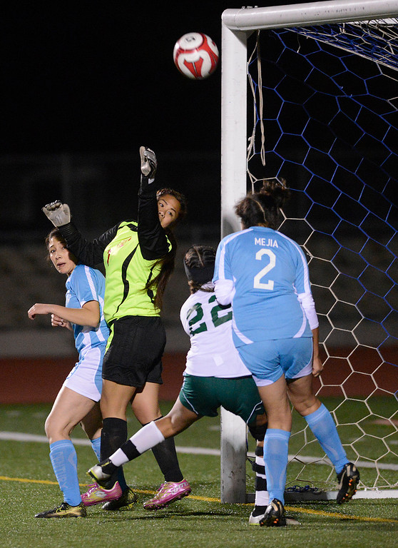 . North Salinas\' goalie Nery Dolor, secomd from left, clears a corner kick attempt by Alisal during girls soccer at Alisal High School in Salinas on Thursday December 1, 2016. (David Royal - Monterey Herald)
