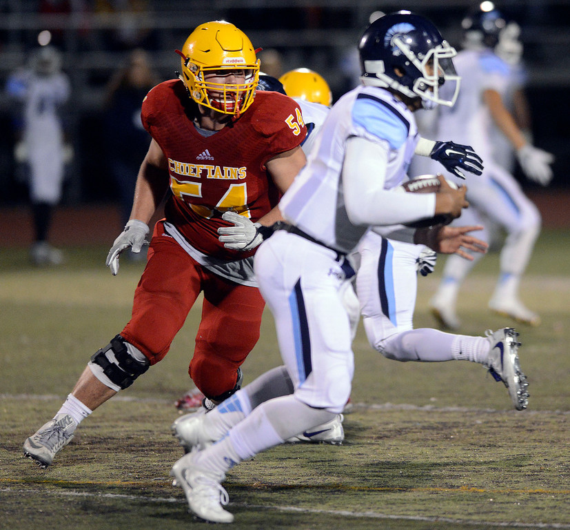 . Palma\'s Drew Dalman chases down Valley Christian quarterback Miles Kendrick to log a sack during the CCS Open Division III championship football game at Oak Grove High School in San Jose on Friday November 25, 2016. (David Royal - Monterey Herald)
