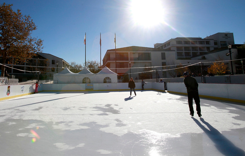 . People skate on the ice rink in Monterey at the Custom House Plaza on Tuesday, Nov. 29, 2016.  (Vern Fisher - Monterey Herald)