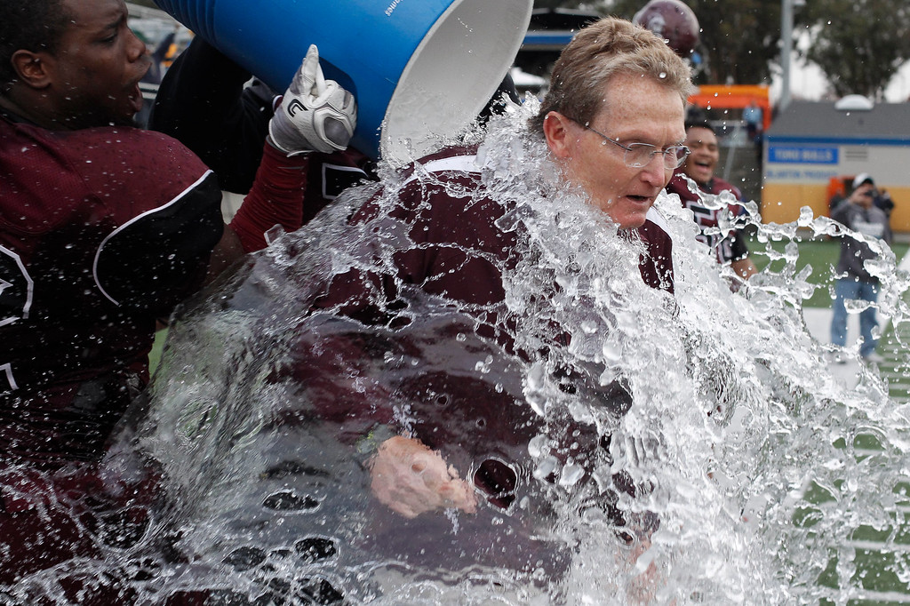 . MPC head coach Mike Rasmussen is doused with water after winning the Living Breath Foundation Bowl against Los Medanos at Rabobank Stadium on Saturday, Nov. 26, 2016 in Salinas, Calif. (Vernon McKnight/Herald Correspondent)