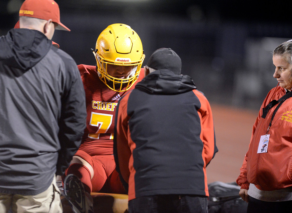 . Palma mediacal staff examine lineman Robert Hernandez after he was carried off the field during the CCS Open Division III championship football against Valley Christian at Oak Grove High School in San Jose on Friday November 25, 2016. (David Royal - Monterey Herald)