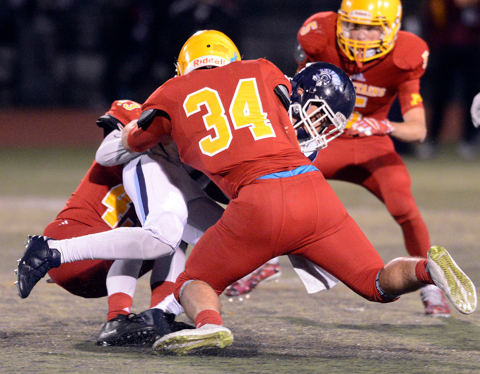 . Palma\'s Michael Zaragoza and Stanley Smith (34) sack Valley Christian quarterback Miles Kendrick during the CCS Open Division III championship football game at Oak Grove High School in San Jose on Friday November 25, 2016. (David Royal - Monterey Herald)