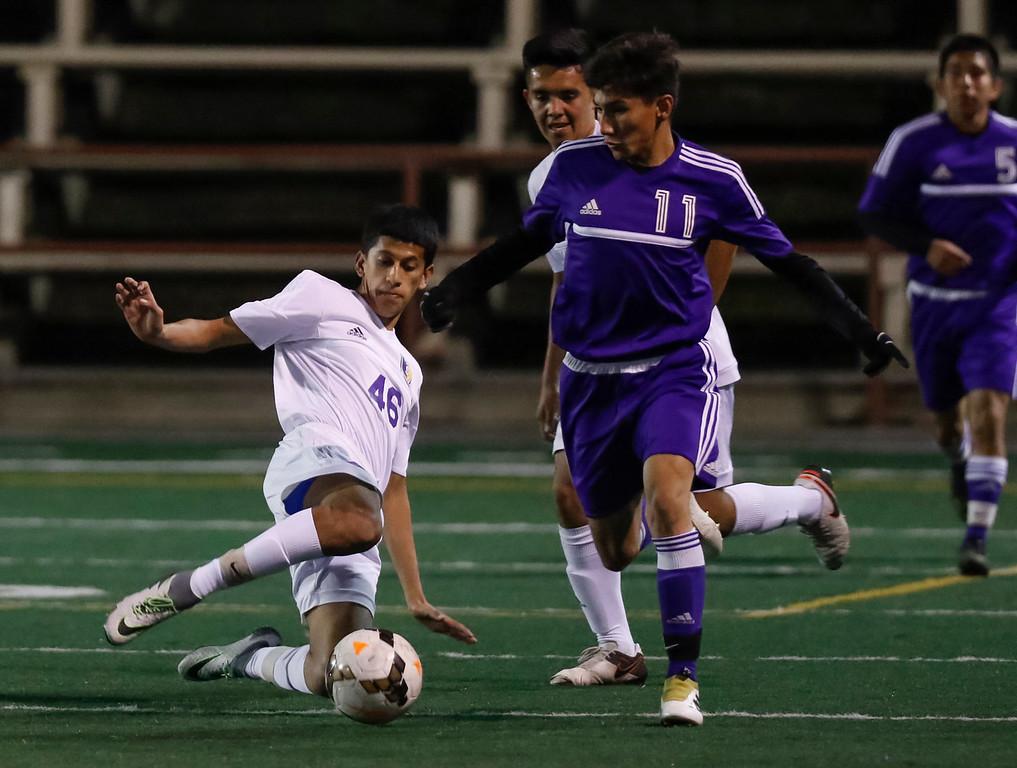 . Salinas\' Carlos Torres kicks the ball past Soledad\'s Anthony Garcia during a non-conference CCS boys soccer game at Salinas High School on Tuesday, Nov. 29, 2016 in Salinas, Calif. (Vernon McKnight/Herald Correspondent)