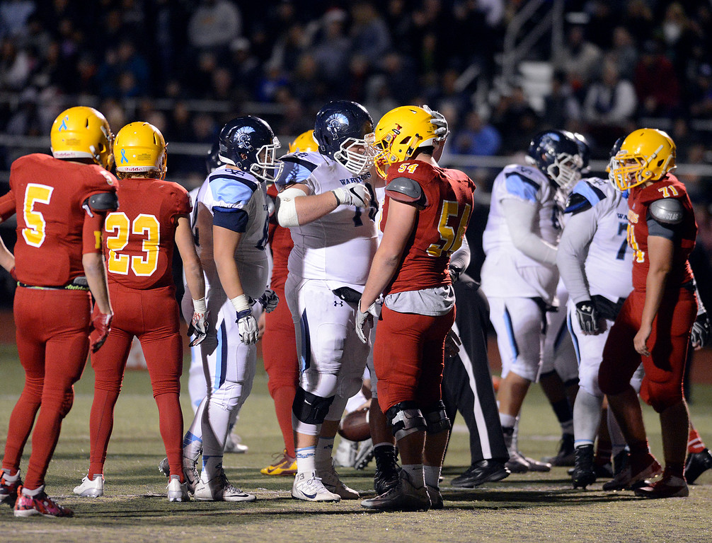 . Valley Christian\'s David Beltramo, center left, speaks with Palma\'s Drew Dalman as the clock runs out during Palma\'s loss during the CCS Open Division III championship football game at Oak Grove High School in San Jose on Friday November 25, 2016. (David Royal - Monterey Herald)