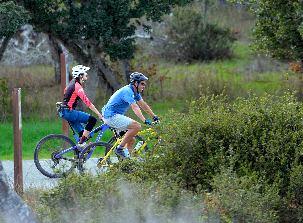 . Jason Hajduk of Aptos and his cousin Andrea Turner ride near Eighth Avenue and Gigling Road at the end of a bike ride on the nearby roads on Fort Ord in Seaside on Friday November 25, 2016. (David Royal - Monterey Herald)