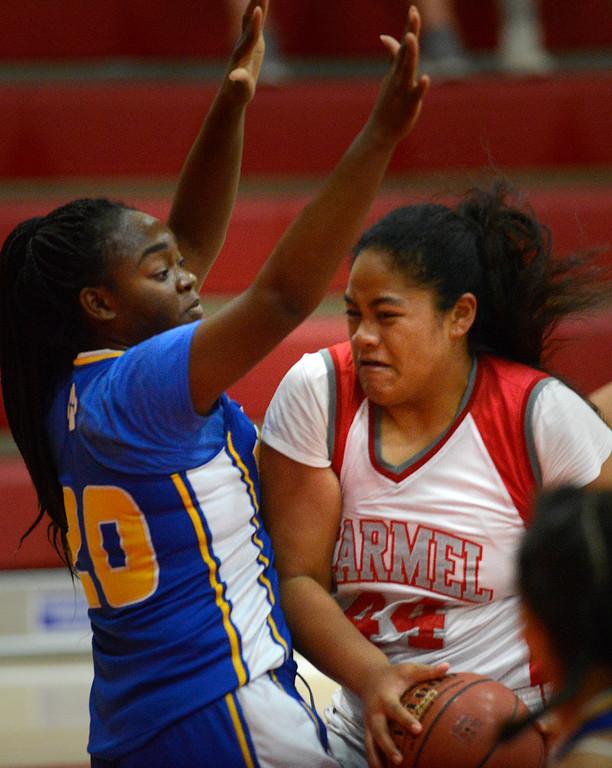 . Carmel\'s Soana Laulotu charges the basket against Prospect\'s Perla Mbumba during girls basketball in Carmel on Wednesday November 30, 2016. (David Royal - Monterey Herald)