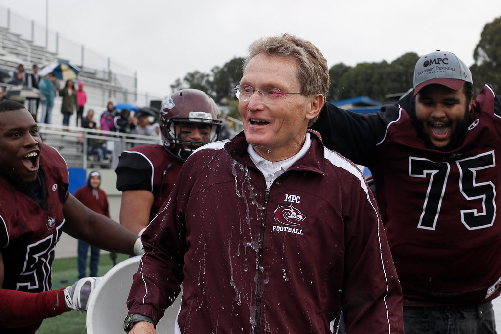 . MPC head coach Mike Rasmussen reacts after being doused with water after winning the Living Breath Foundation Bowl against Los Medanos at Rabobank Stadium on Saturday, Nov. 26, 2016 in Salinas, Calif. (Vernon McKnight/Herald Correspondent)