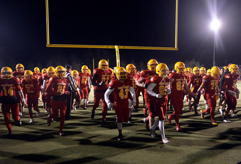. Palma players head to the locker room after a tough first half against Valley Christian during the CCS Open Division III championship football game at Oak Grove High School in San Jose on Friday November 25, 2016. (David Royal - Monterey Herald)