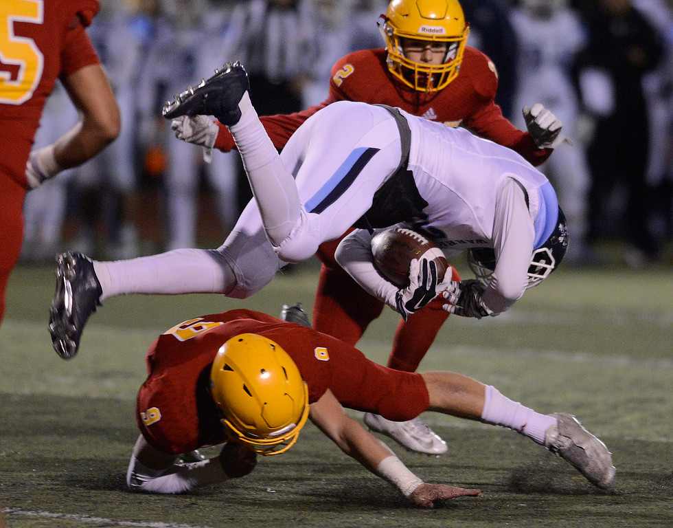 . Palma\'s Tristan Wahl upends Valley Christian\'s Isaiah Rodriguez during the CCS Open Division III championship football game at Oak Grove High School in San Jose on Friday November 25, 2016. (David Royal - Monterey Herald)