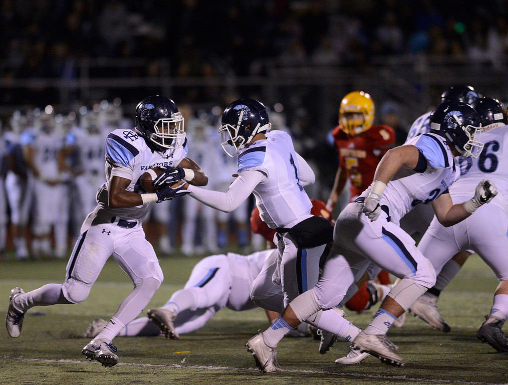 . Valley Christian quarterback Miles Kendrick hands off to Javon Sturns during the CCS Open Division III championship football game against Palma at Oak Grove High School in San Jose on Friday November 25, 2016. (David Royal - Monterey Herald)
