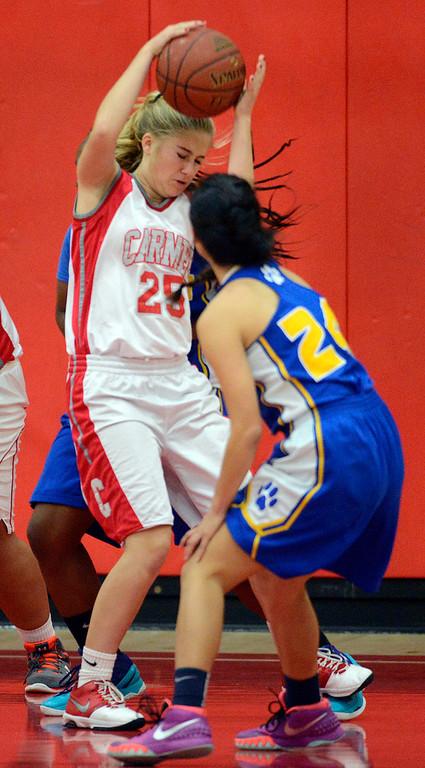 . Carmel\'s Melissa Pavloff reels in a rebound against Prospect during girls basketball in Carmel on Wednesday November 30, 2016. (David Royal - Monterey Herald)