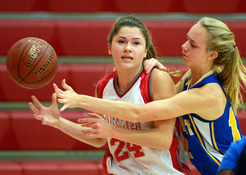 . Carmel\'s Jessica DiLullo and Prospect\'s Danielle Seran fight for a loose ball during girls basketball in Carmel on Wednesday November 30, 2016. (David Royal - Monterey Herald)
