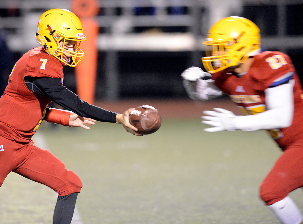 . Palma quarterback Zach Flores hands off to Emelio Martinez against Valley Christian during the CCS Open Division III championship football game at Oak Grove High School in San Jose on Friday November 25, 2016. (David Royal - Monterey Herald)