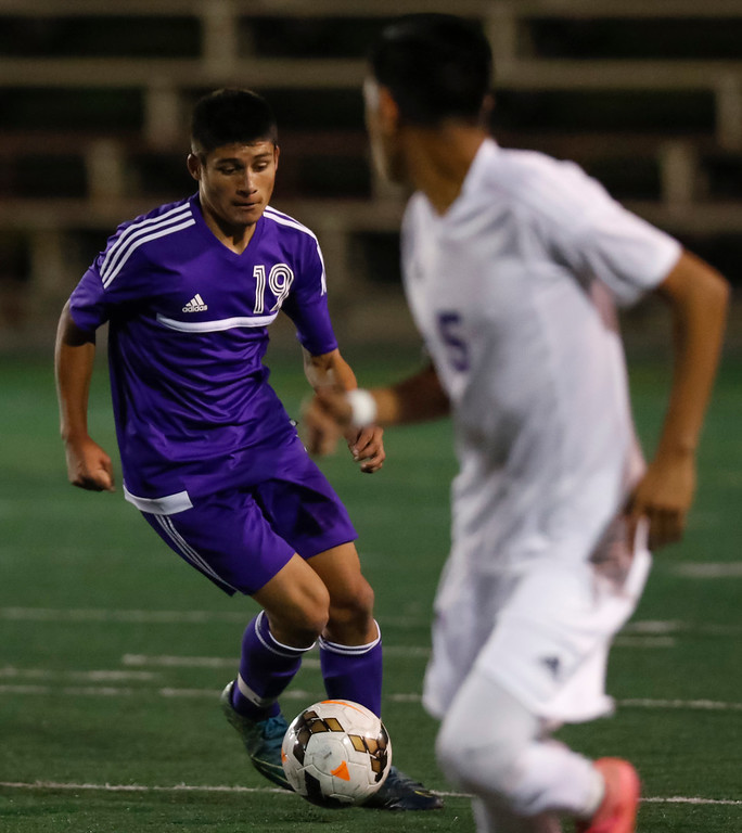 . Soledad\'s Eduardo Chavez controls the ball as Salinas\' Conrado Gudino defends during a non-conference CCS boys soccer game at Salinas High School on Tuesday, Nov. 29, 2016 in Salinas, Calif. (Vernon McKnight/Herald Correspondent)
