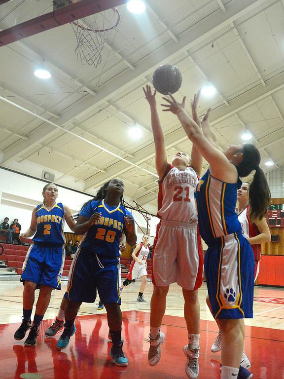 . Carmel\'s Ashlyn Davis reels in a rebound against Prospect during girls basketball in Carmel on Wednesday November 30, 2016. (David Royal - Monterey Herald)