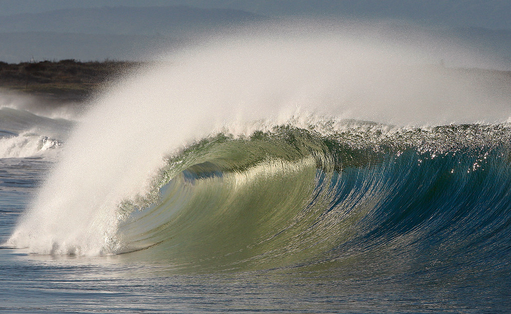 . A large waves break on the south side of the Moss Landing Harbor in Tuesday, Nov. 29, 2016.  (Vern Fisher - Monterey Herald)