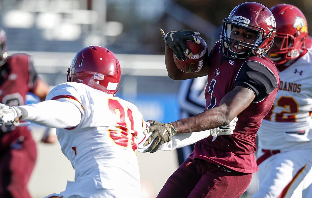 . MPC\'s Deryan Sanders evades Los Medanos\' Alex Bazan tackle during the Living Breath Foundation Bowl at Rabobank Stadium on Saturday, Nov. 26, 2016 in Salinas, Calif. (Vernon McKnight/Herald Correspondent)