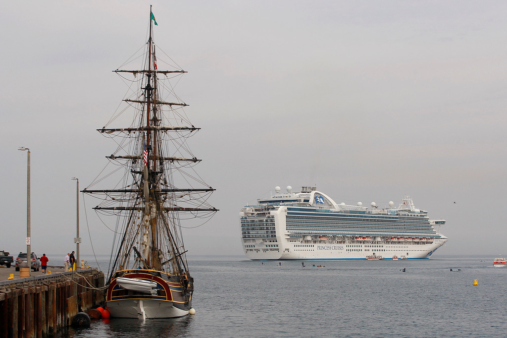 . The tall ship Lady Washington tied at Wharf No. 2 in Monterey for some general maintenance as a Princess Cruises cruise ship sits at anchor off Monterey Harbor on Tuesday, November 13, 2018.  (Vern Fisher - Monterey Herald)