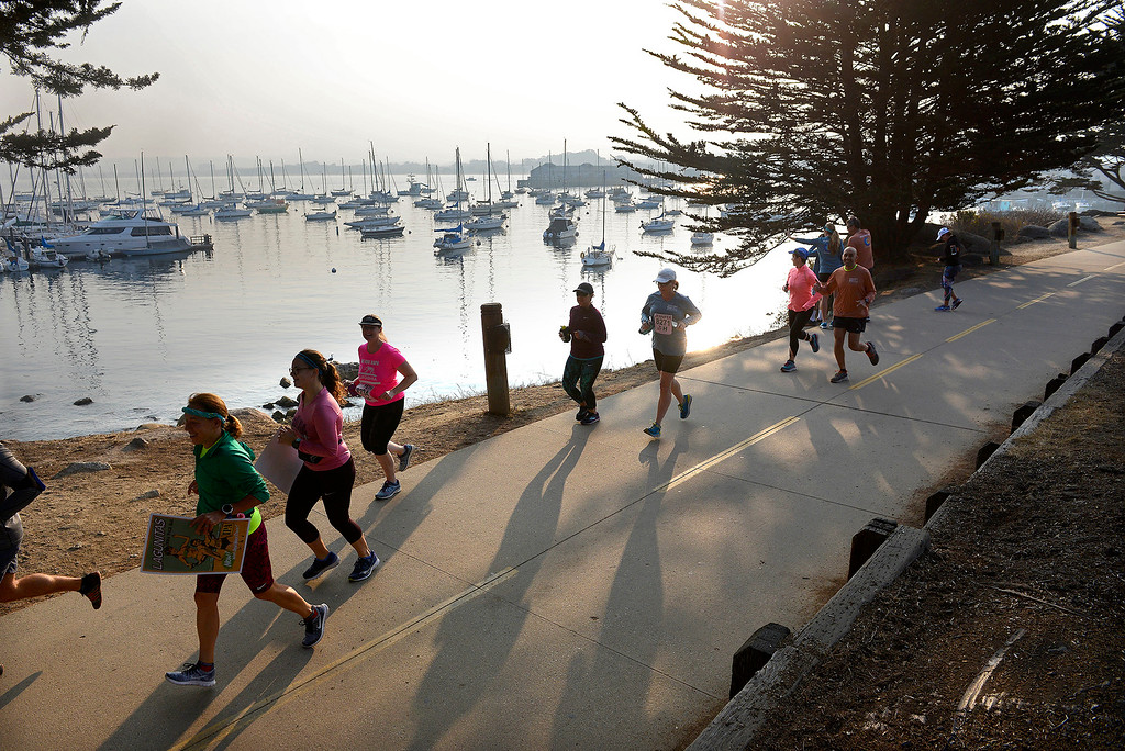 . Dozens of marathon participants decided to run the race course in Monterey on Sunday, November 11, 2018.  The Big Sur Half Marathon was cancelled due to poor air conditions from the Camp Fire in northern California.  (Vern Fisher - Monterey Herald)