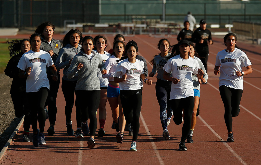 . Members of Hartnell College Women\'s Cross Country Team run during practice at the Hartnell Track in Salinas on Wednesday November 14, 2018. (David Royal/ Herald Correspondent)