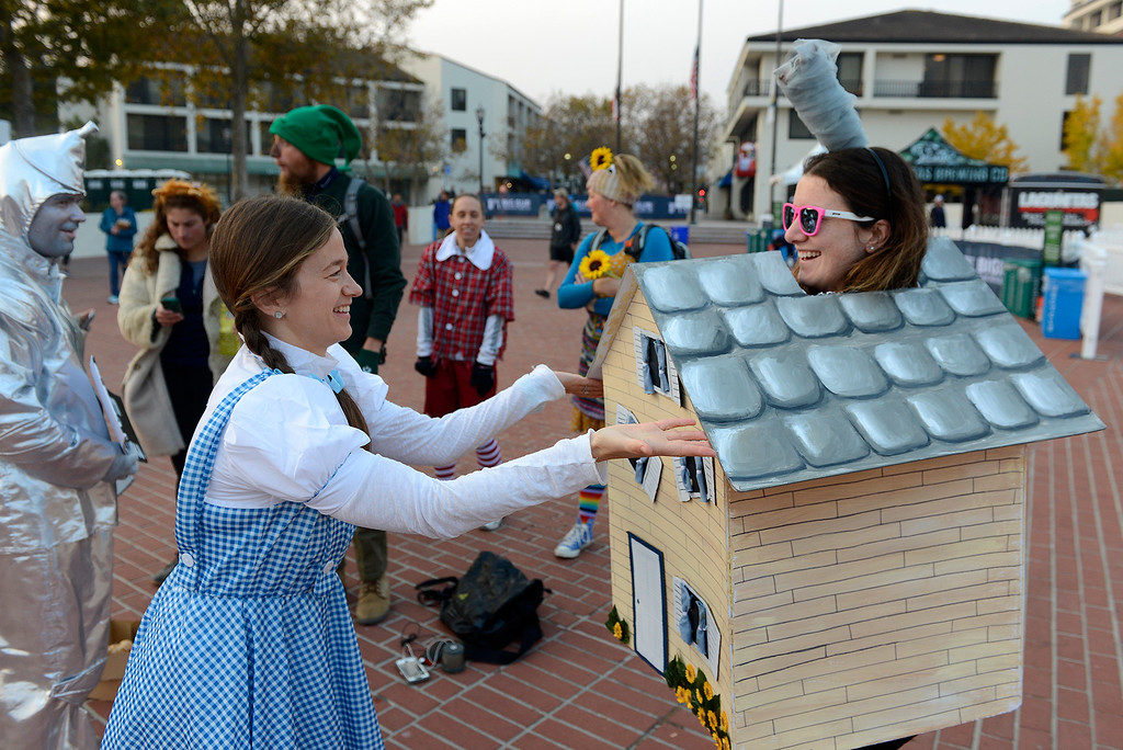 . Megan Roach and Lyndsay Guttchen dressed in costumes from the Wizard of Oz to entertain runners participating om the Big Sur Half Marathon in Monterey on Sunday, November 11, 2018.  The Big Sur Half Marathon was cancelled due to poor air conditions from the Camp Fire in northern California.  (Vern Fisher - Monterey Herald)