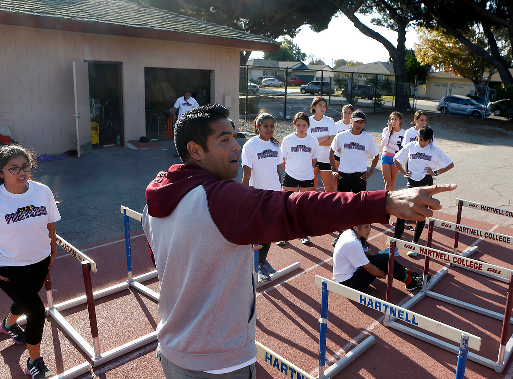 . Hartnell College Women\'s Cross Country coach Chris Zepeda gives instructions to team members during practice at the Hartnell Track in Salinas on Wednesday November 14, 2018. (David Royal/ Herald Correspondent)