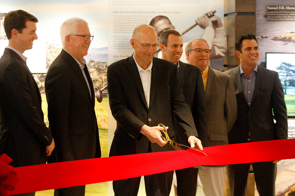 . Bill Perocchi (center) CEO of the Pebble Beach Company cuts the ribbon during the grand opening of the Pebble Beach Visitor Center on Tuesday, November 13, 2018.  (Vern Fisher - Monterey Herald)