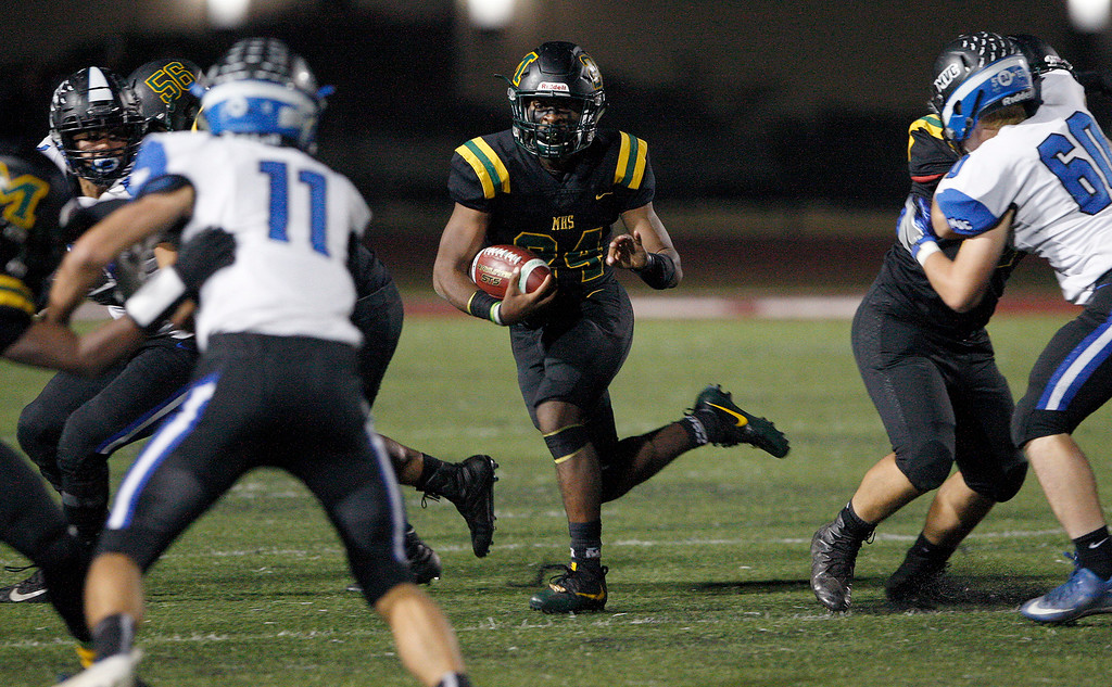 . Monterey High School\'s Tim Byrd (24) runs for yards in the first half of their CCS DV playoff game against Monte Vista Christian at Monterey Peninsula College on Friday, November 9, 2018.  (Vern Fisher - Monterey Herald)