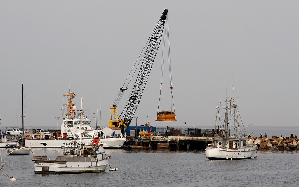 . Work continues at the Coast Guard jetty and pier in Monterey on Tuesday, November 13, 2018.  (Vern Fisher - Monterey Herald)