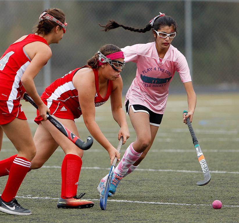 . Carmel\'s Chloe Prichard (19) battles Monterey\'s Sinai Nieto (41) during their match at Monterey High on Tuesday, Oct. 17, 2017.  (Vern Fisher - Monterey Herald)