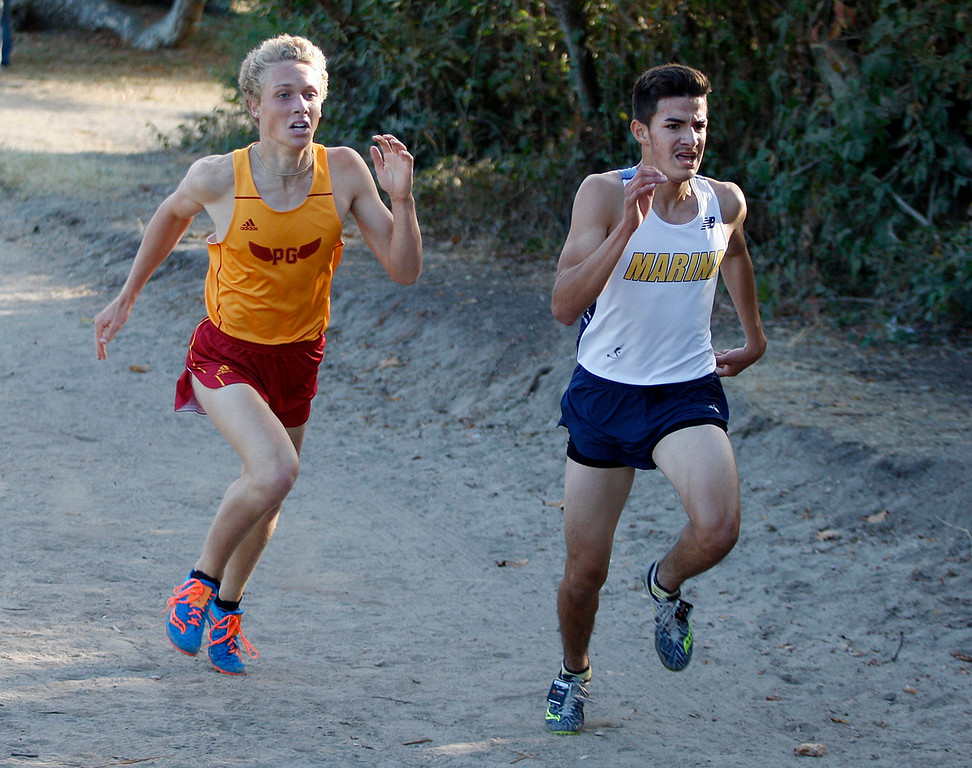 . Pacific Grove High\'s Will Stefanou chases Marina High\'s Christopher Plascensia during the MTAL Cross Country Center Meet at Toro Park on Thursday, Oct. 19, 2017.  Stefanou placed second and Plascensia finshed first.  (Vern Fisher - Monterey Herald)