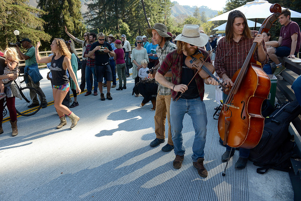 . The Big Sur band Wayward Jerry plays music during the opening of the Pfeiffer Canyon Bridge on Highway One in Big Sur on Friday, Oct. 13, 2017 after eight months of construction and $24 million.   (Vern Fisher - Monterey Herald)