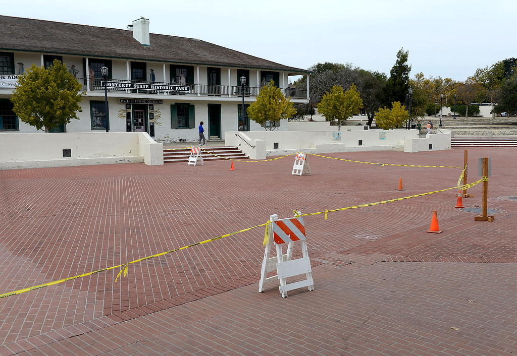 . A section of the Custom House Plaza has caution tape due to cracks in the bricks on Tuesday, Oct. 17, 2017.   (Vern Fisher - Monterey Herald)
