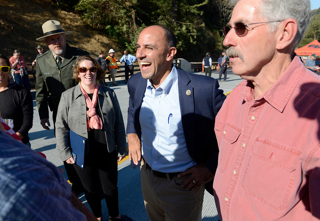 . Congressman Jimmy Panetta talks with Big Sur residents during the opening of the Pfeiffer Canyon Bridge on Highway One in Big Sur on Friday, Oct. 13, 2017 after eight months of construction and $24 million.   (Vern Fisher - Monterey Herald)