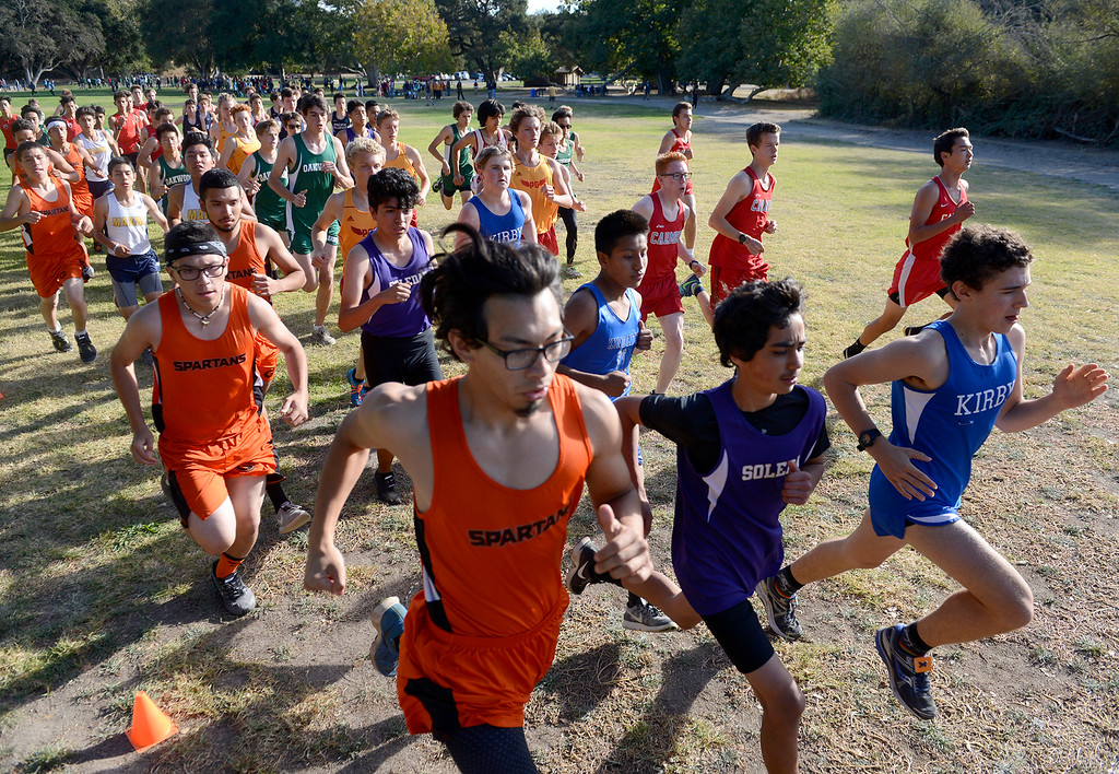 . The start of the boys varsity race at the MTAL Cross Country Center Meet at Toro Park on Thursday, Oct. 19, 2017.  (Vern Fisher - Monterey Herald)