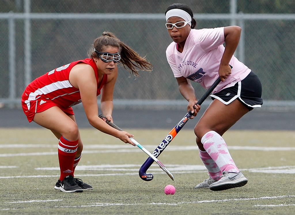 . Carmel\'s Serena Valdez Klemek (12) battles Monterey\'s Jada Williams (20) during their match at Monterey High on Tuesday, Oct. 17, 2017.  (Vern Fisher - Monterey Herald)