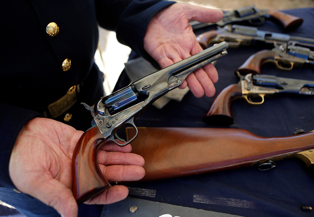 . paul Lavrischeff holds a replica of a Civil War era Navy Colt at the encampment at the Lower Presidio Park in Monterey on Saturday October 14, 2017. The event was part of History Fest. (David Royal/Herald Correspondent)