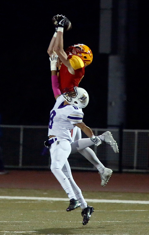 . Pacific Grove\'s Hunter Hanes reels in a pass over Soledad\'s Aaron Rodriguez  during football at Pacific Grove on Friday October 13, 2017. (David Royal/Herald Correspondent)