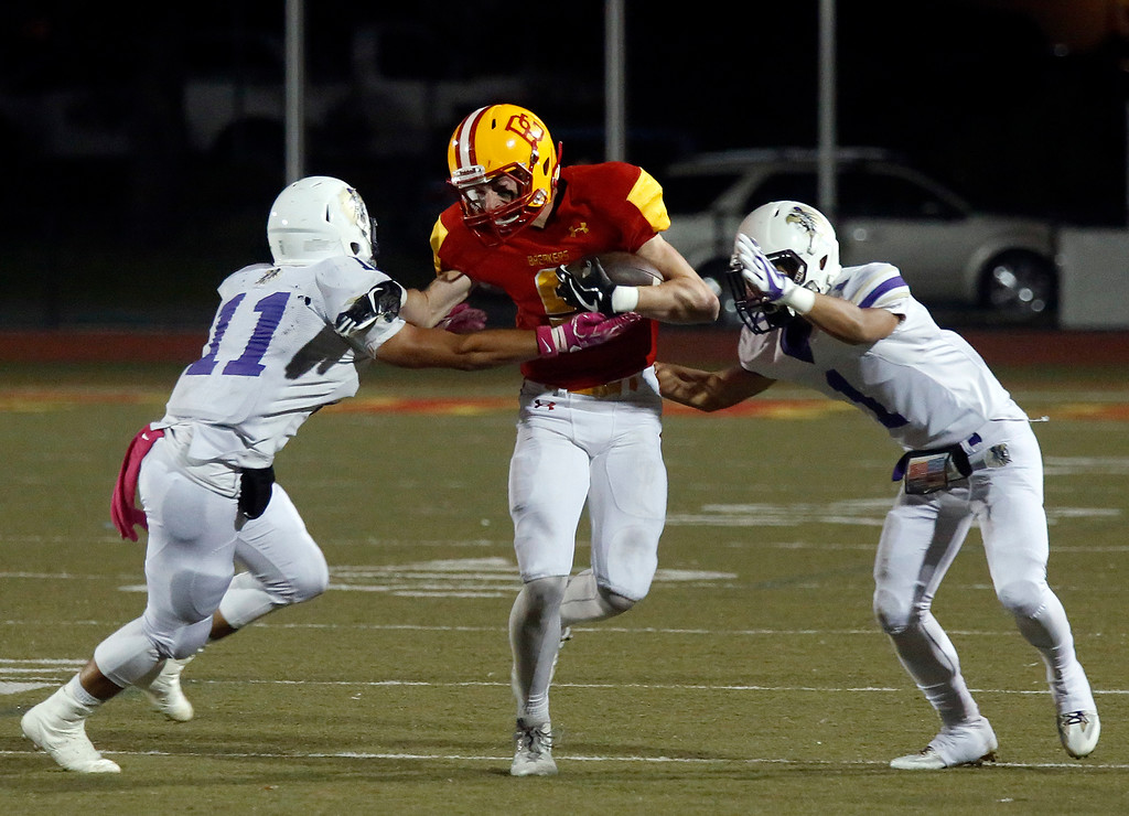 . Pacific Grove\'s Hunter Hanes is sandwiched between Soledad\'s Robbie Santa Ana, left, and Marcus Morales during football at Pacific Grove on Friday October 13, 2017. (David Royal/Herald Correspondent)