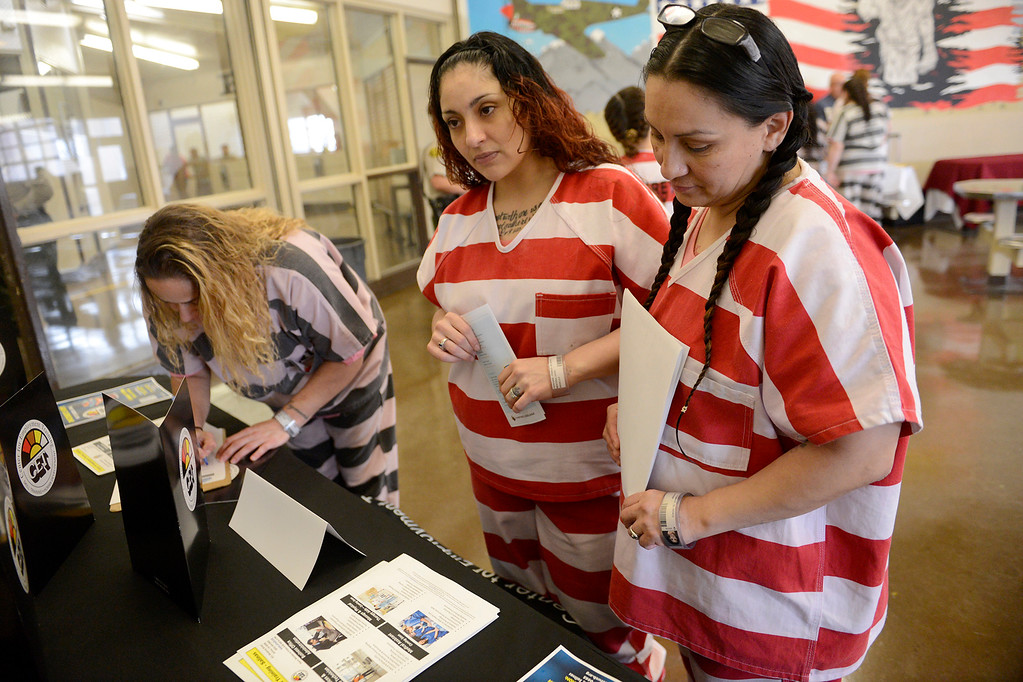 . Monterey County Jail inmates Dora Renteria and Sarina Morfin at the Monterey County jail job fair on Thursday, Oct. 19, 2017.  The Monterey County Sheriff\'s Office in partnership with GEO Reentry Services held a job fair for jail inmates and local employers on Oct. 19 at the Monterey County Jail in Salinas.  (Vern Fisher - Monterey Herald)