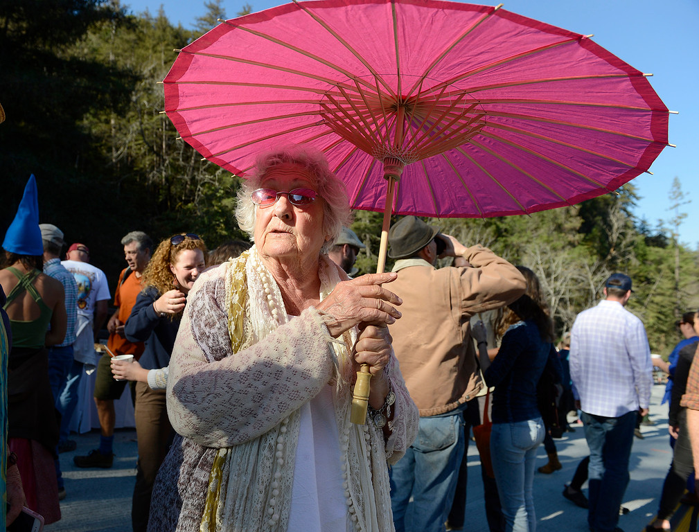 . Big Sur resident Clovis Harrod on the new Pfeiffer Canyon Bridge on Highway One in Big Sur during the opening celebration on Friday, Oct. 13, 2017 after eight months of construction and $24 million.   (Vern Fisher - Monterey Herald)