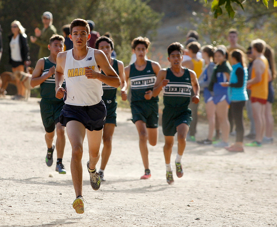 . Marina High\'s Christopher Plascensia leads a group of runners on his way to winning the MTAL Cross Country Center Meet at Toro Park on Thursday, Oct. 19, 2017.  (Vern Fisher - Monterey Herald)