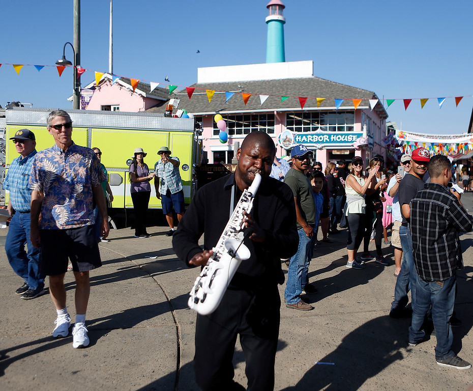 ". Nathaniel McGriff walks through the crowd as he solos on saxophone while performing with the Anthony ""Nino\"" Lane Band as Fisherman\'s Wharf celebrates its 172 birthday in Monterey on Sunday October 15, 2017. (David Royal/Herald Correspondent)"