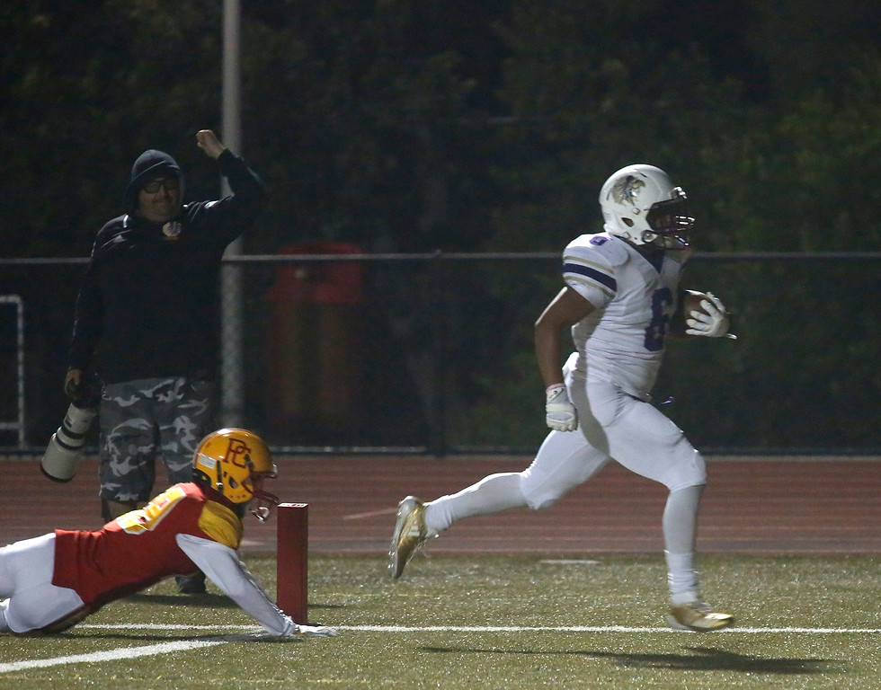 . Soledad\'s Ulises Uribe runs in a touchdown during football at Pacific Grove on Friday October 13, 2017. (David Royal/Herald Correspondent)