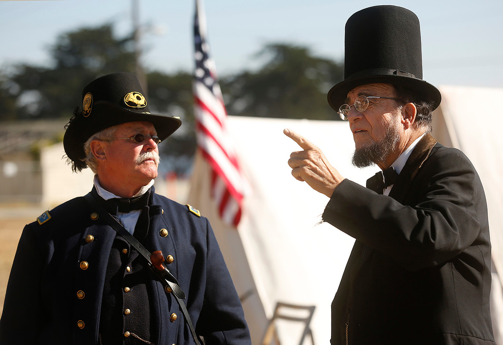 ". Wayne Scott, dressed as Abraham Lincoln speaks to Randy Hawkinson, dressed as  Union Col. Lewis ""Lew\"" Wallace at their Civil War encampment at the Lower Presidio Park in Monterey on Saturday October 14, 2017. The event was part of History Fest. (David Royal/Herald Correspondent)"