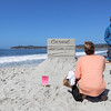 during the Great Sand Castle Contest of Carmel on Sunday, October 4, 2015 in Carmel by the Sea, Calif. (Vernon McKnight/Herald Todd Weaver, right, of Carmel explains how his entry titled Carmel Postcard is designed to line up exactly with the trees in the background, the horizon, and the waves crashing onto the beach and the best angle to view it during the Great Sand Castle Contest of Carmel on Sunday, October 4, 2015 in Carmel by the Sea, Calif. (Vernon McKnight/Herald Correspondent))
