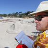 Judge and professional sand sculptor Rusty Croft looks on as he judges an entry titled, Wish You Were Here during the Great Sand Castle Contest of Carmel on Sunday, October 4, 2015 in Carmel by the Sea, Calif. (Vernon McKnight/Herald Correspondent)